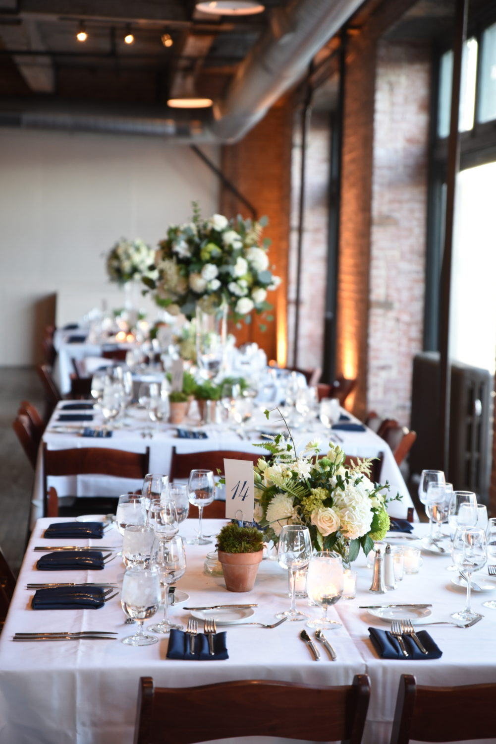 classic white and green table arrangements