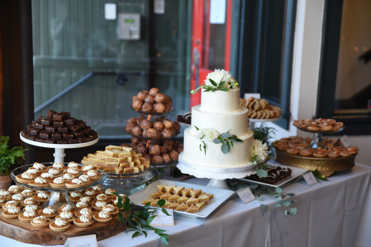 cake table with mixed desserts