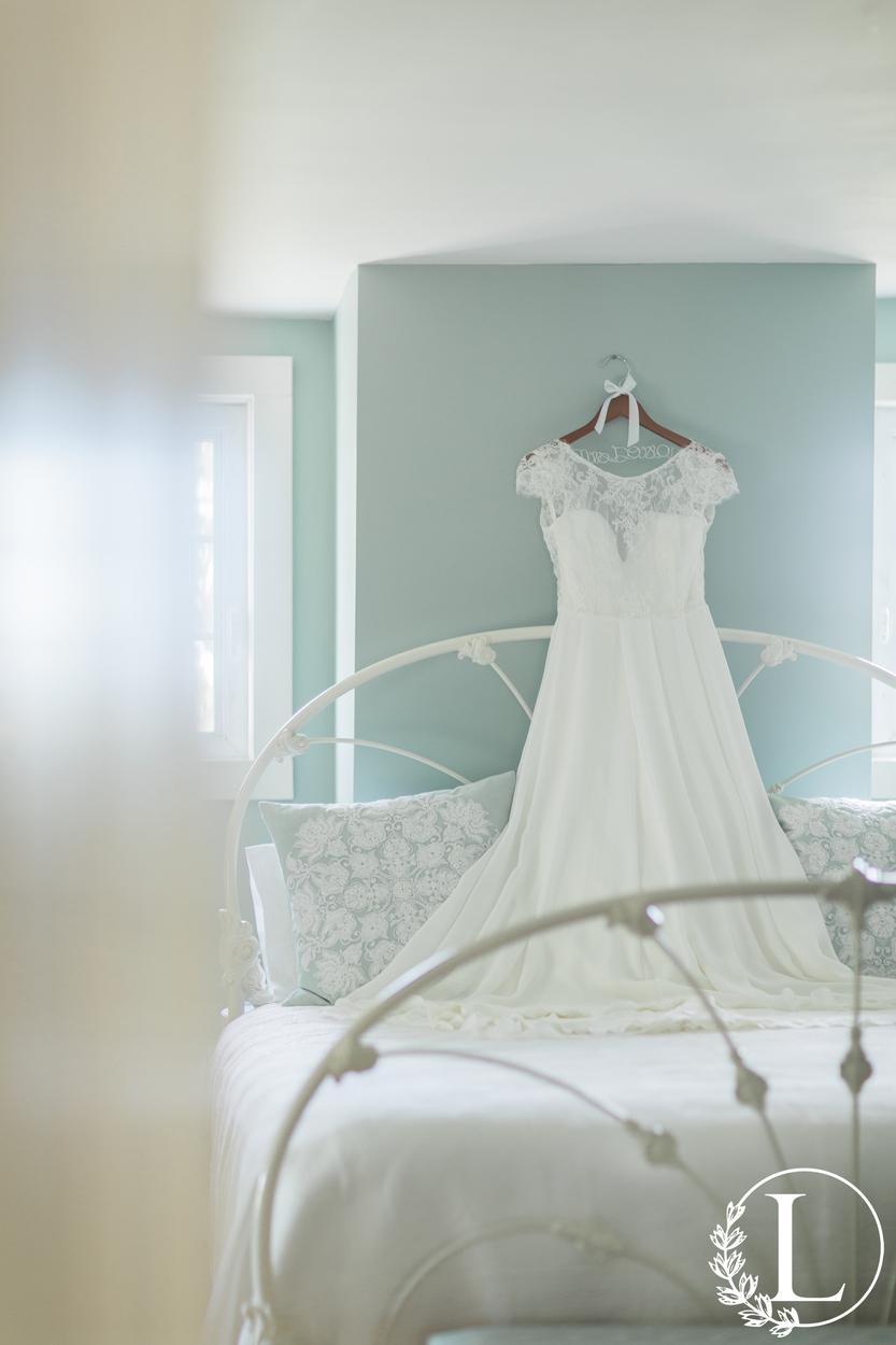 cap sleeve ivory wedding gown