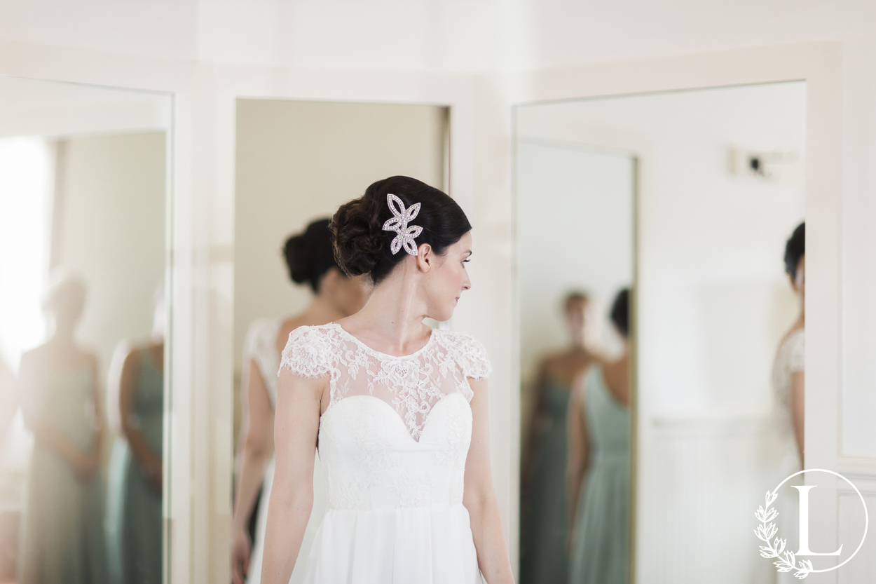 lace wedding gown with open back and cap sleeve
