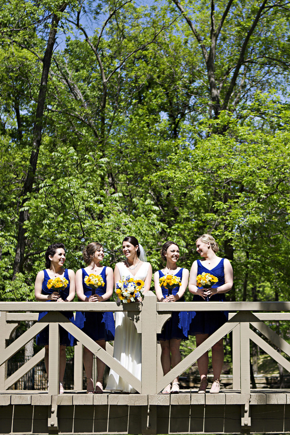 Bright floral bridesmaids bouquets Sidelines Floral