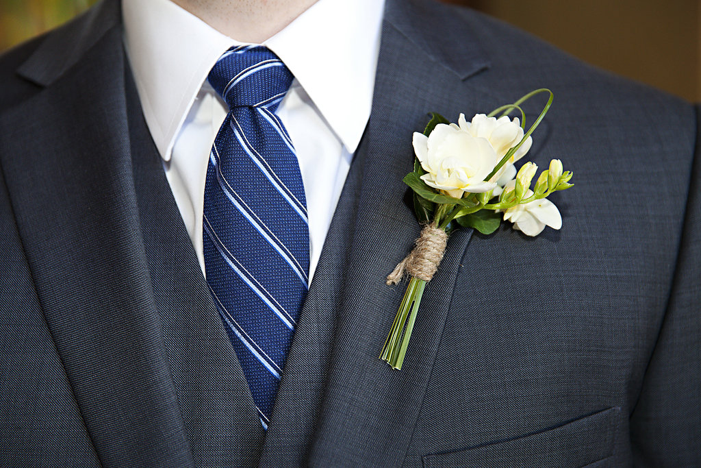 white and green groom boutinnerie Sidelines Floral